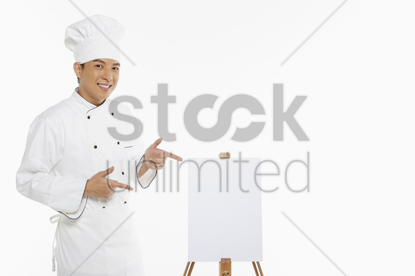 chef showing a hand gesture stock photo