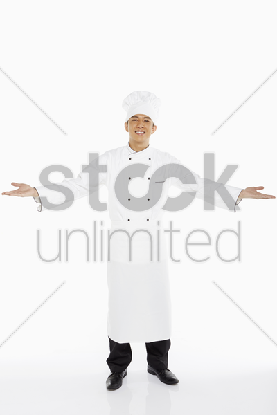 chef showing a welcome hand gesture stock photo
