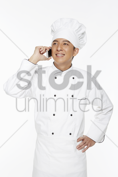chef talking on his mobile phone stock photo