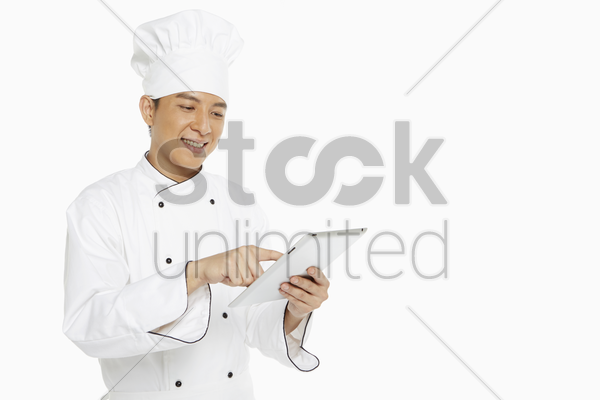 chef using a digital tablet stock photo