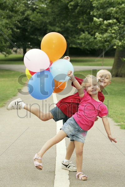 children having fun with balloons stock photo