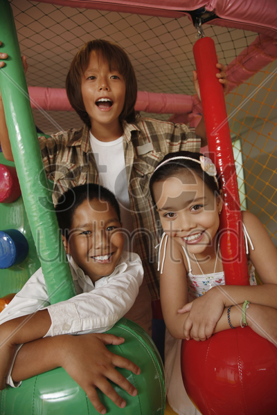 children posing with rope swing indoors stock photo