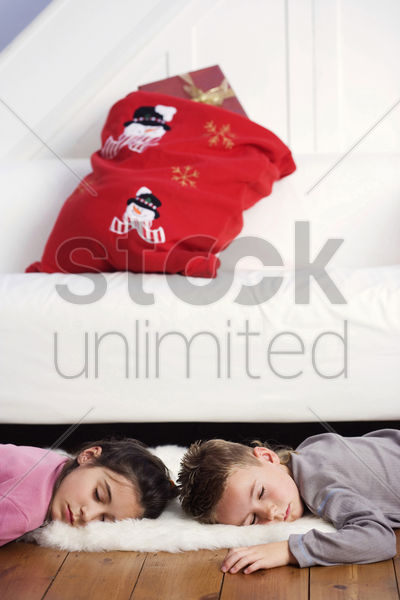 children sleeping on the floor stock photo