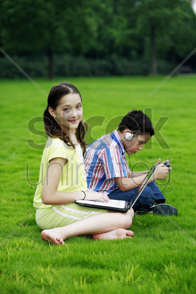 children with gadgets stock photo