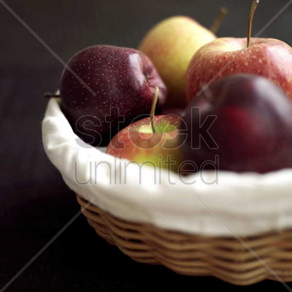 close up of a basket of red apples stock photo