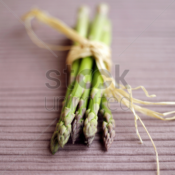 close up of a bundle of asparagus stock photo