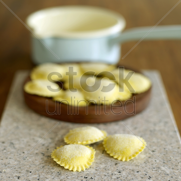 close up of a heap of tortellini pasta stock photo