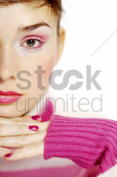 close-up of a woman in pink stock photo