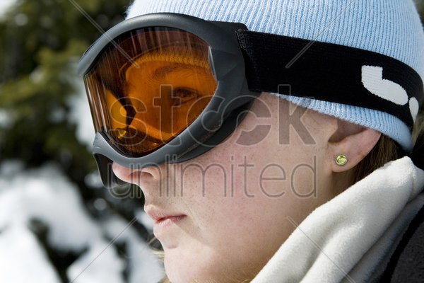 close up of a woman wearing ski goggles stock photo