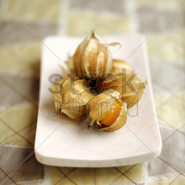 close up of physalis on a small plate stock photo