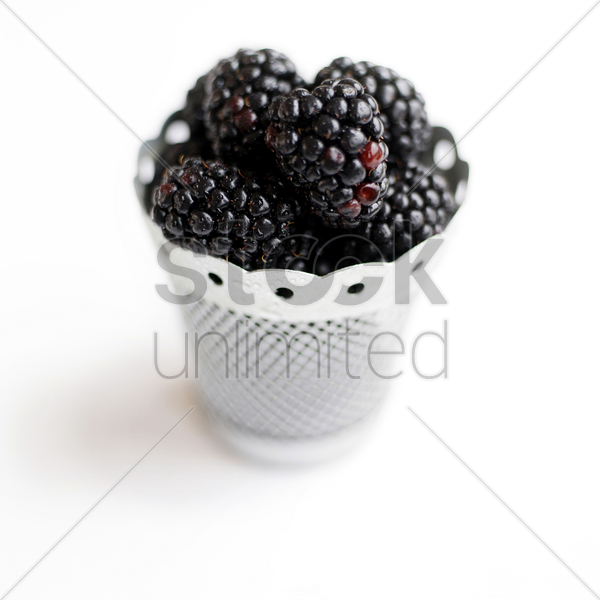 close up of some blackberries in a container stock photo