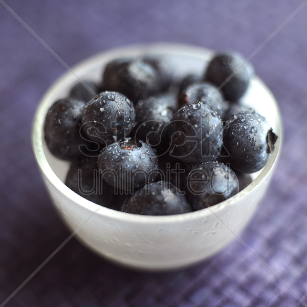 close up of some blueberries in a bowl stock photo