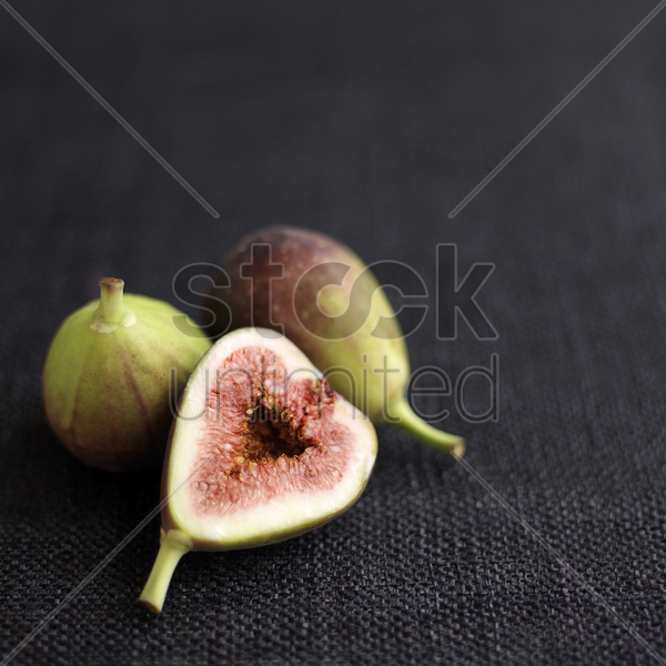close up of some figs on table stock photo