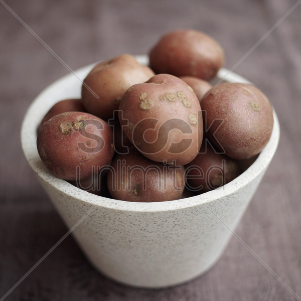 close up of some red potatoes in a bowl stock photo
