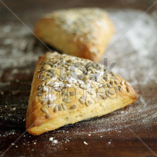 close up of the triangular pastry on table stock photo