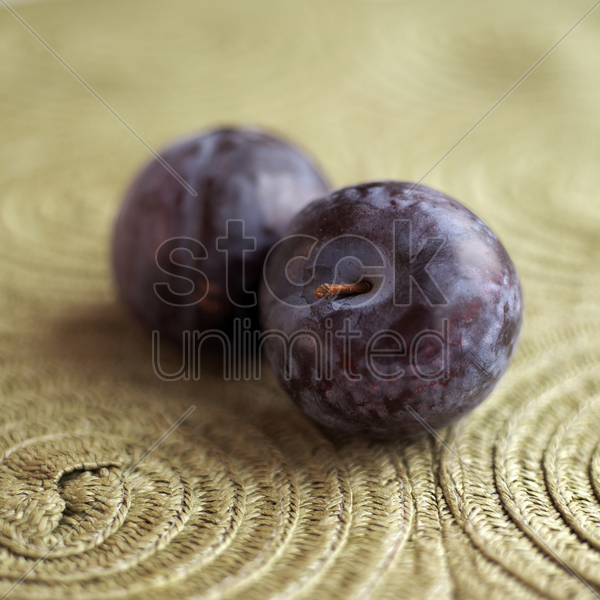 close up of two plums stock photo