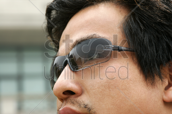 close-up picture of a man wearing sunglass stock photo