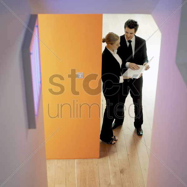 colleagues having discussion stock photo