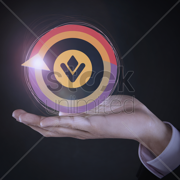 colorful circular logo on top of human hand stock photo