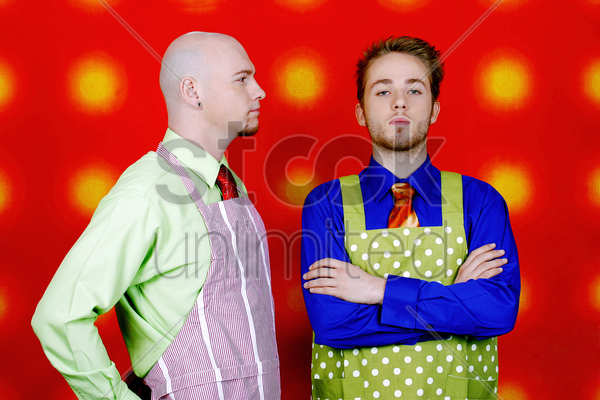 conflict between two businessmen in aprons stock photo