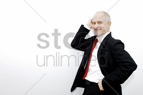 confused looking businessman stock photo