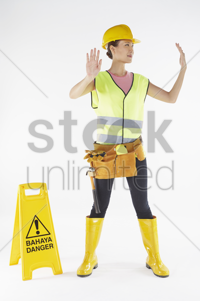 construction worker directing traffic stock photo