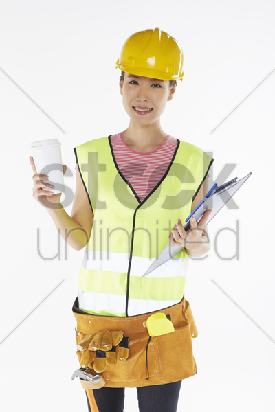 construction worker having a drink stock photo