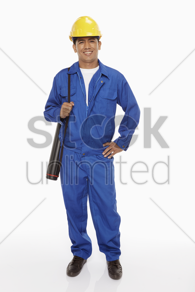 construction worker holding a blueprint plan stock photo