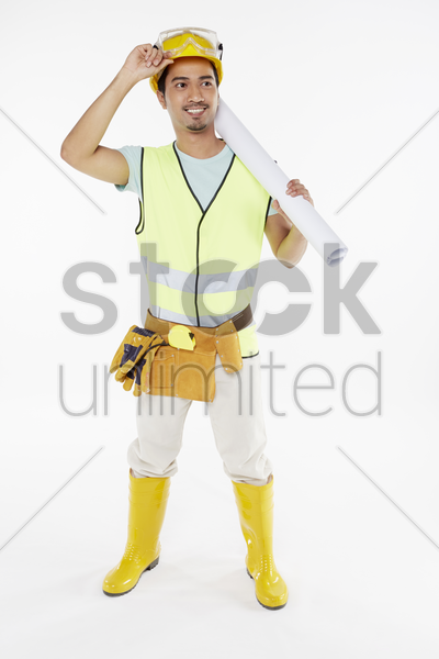 construction worker holding a construction plan stock photo