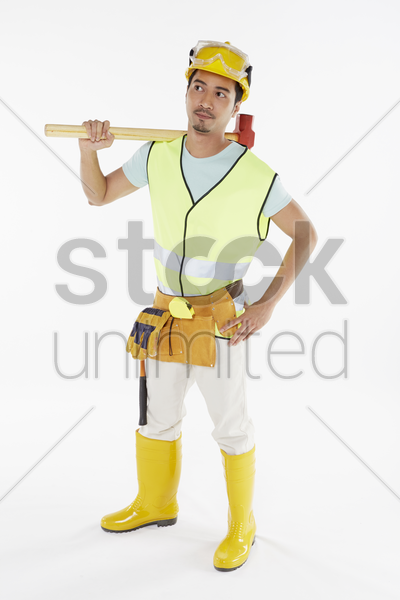 construction worker holding a hammer stock photo