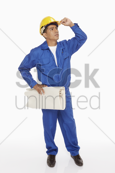 construction worker looking around stock photo
