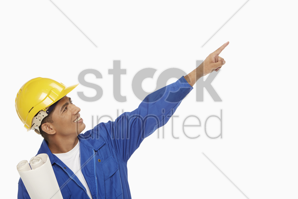 construction worker pointing towards the left stock photo
