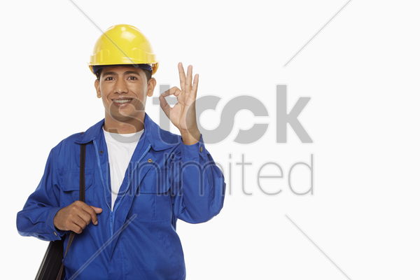 construction worker showing hand gesture stock photo