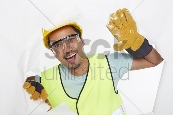 construction worker smiling at the camera stock photo