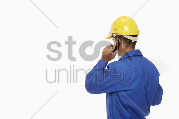 construction worker talking on the phone stock photo