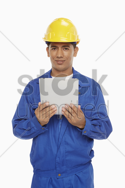 construction worker using a digital tablet stock photo