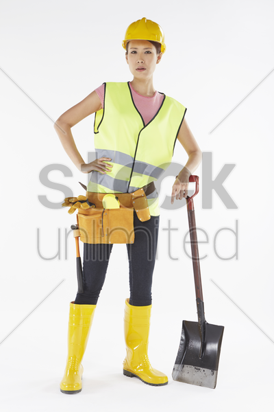 construction worker using a shovel stock photo