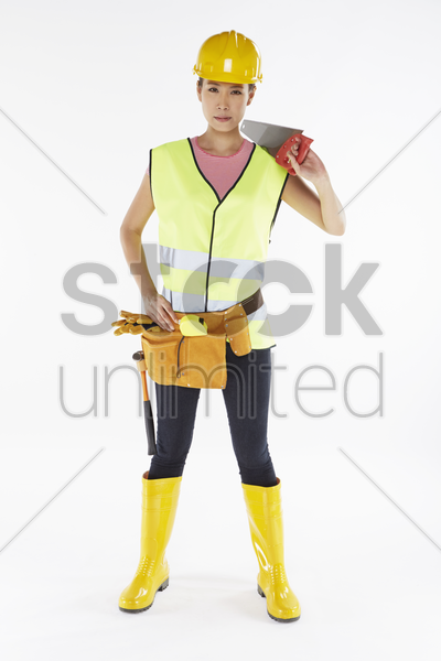 construction worker with tools stock photo