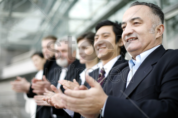 corporate people clapping hands stock photo