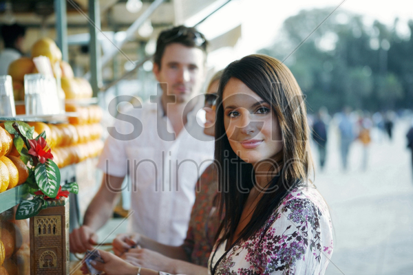 couple at beverage stall stock photo