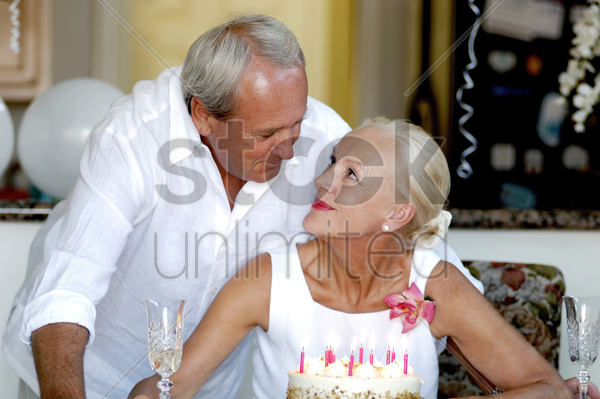 couple celebrating birthday stock photo
