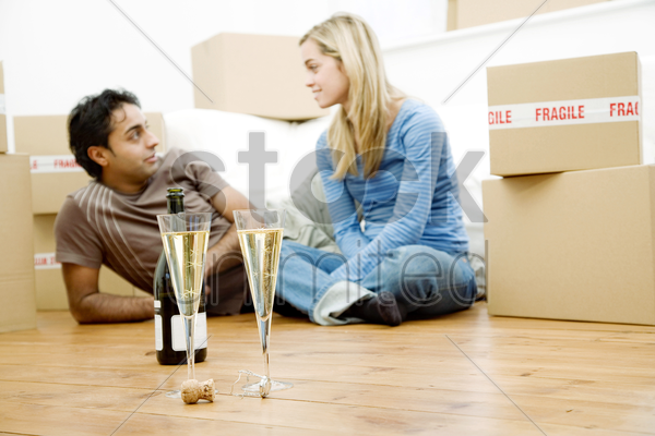 couple celebrating in their new house stock photo
