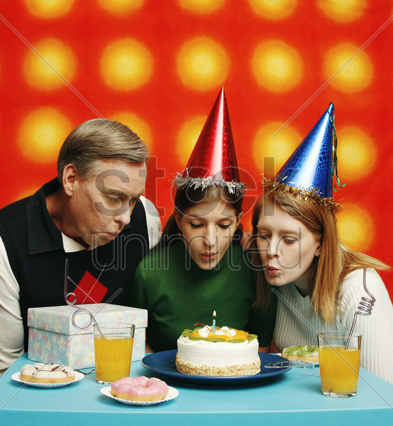 couple celebrating their daughter's birthday stock photo