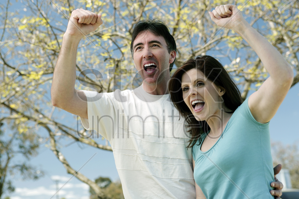 couple cheering out loud stock photo