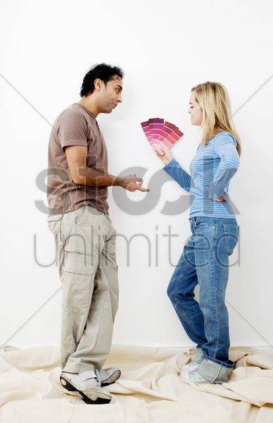 couple choosing suitable colour from the colour chart stock photo