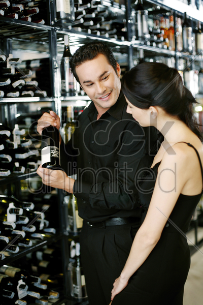 couple choosing wine at wine cellar stock photo