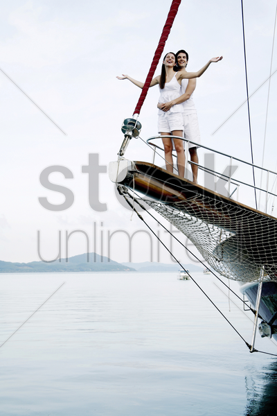 couple cruising on a yacht stock photo