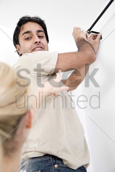 couple doing some diy work in their new house stock photo