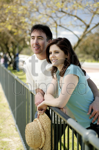 couple enjoying the scenery in the park stock photo