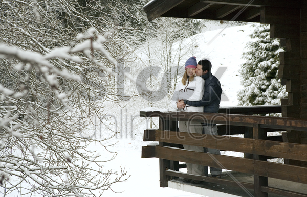 couple enjoying the view from chalet stock photo